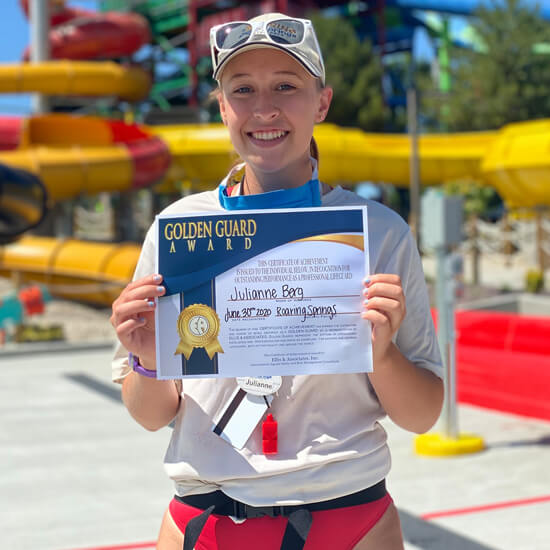 Lifeguard receiving golden guard award