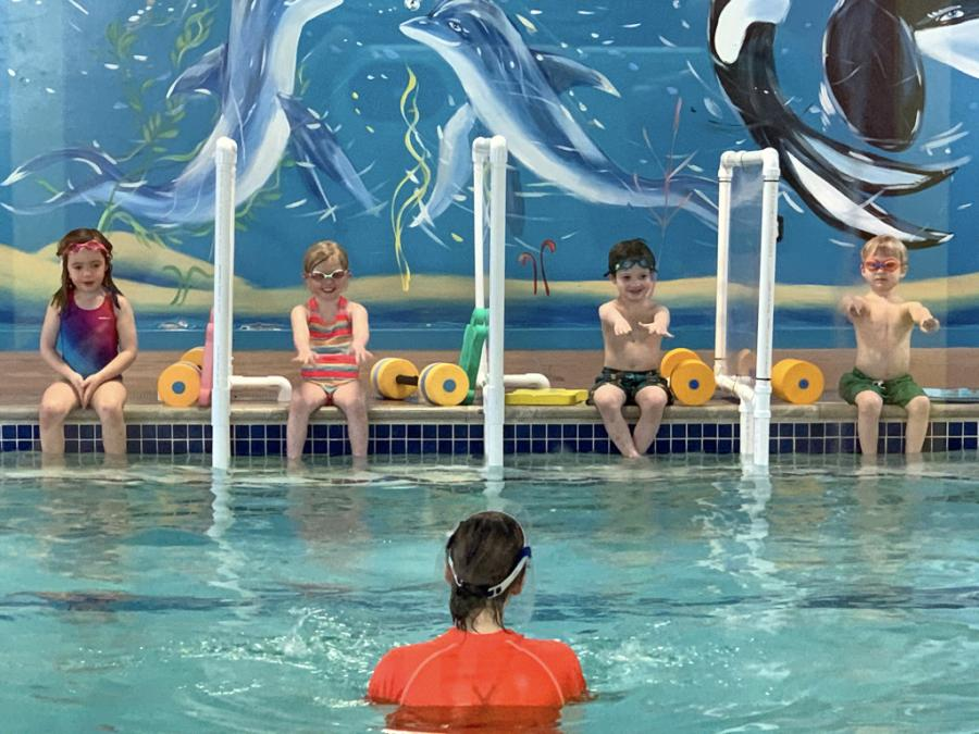 children participating in swim lesson